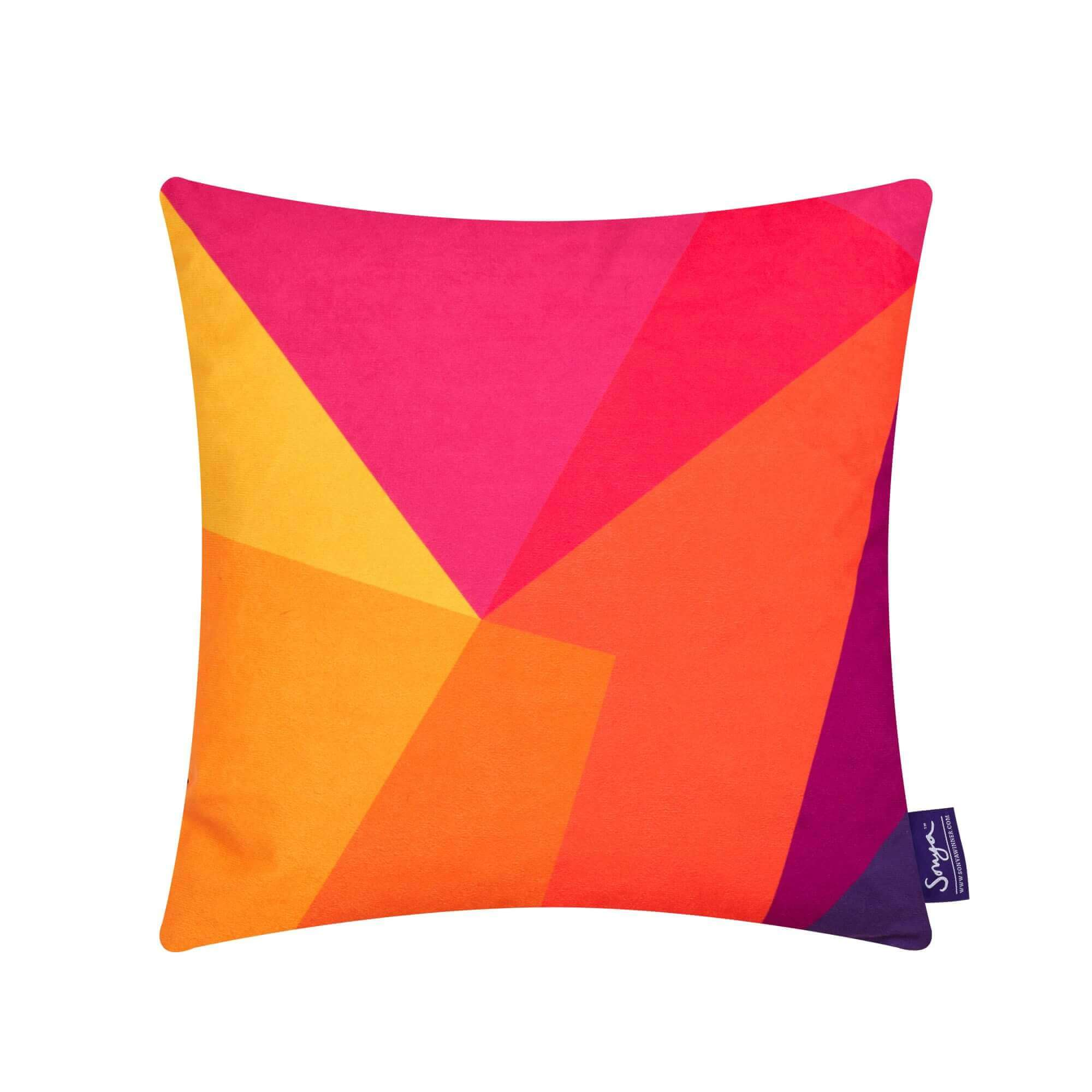 A cropped detail image of the bright and stylish Sonya Winner After Matisse Sunset cushion, showcasing the bright red, yellow and pink colours, geometric pattern and rich texture