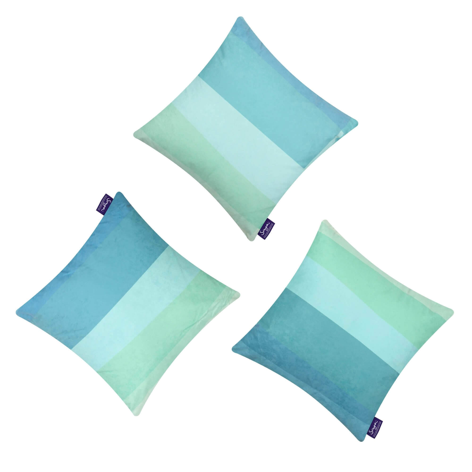 A cropped detail image of the square decorative Aqua Teal cushions set, showcasing the calming turquoise colours, the geometric pattern and elegant faux suede texture