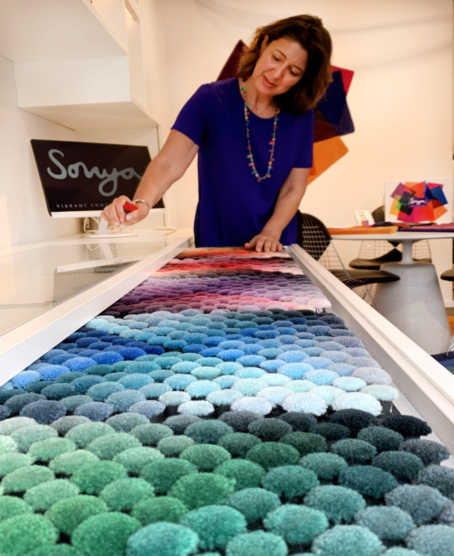 Sonya choosing rug colours in her London studio