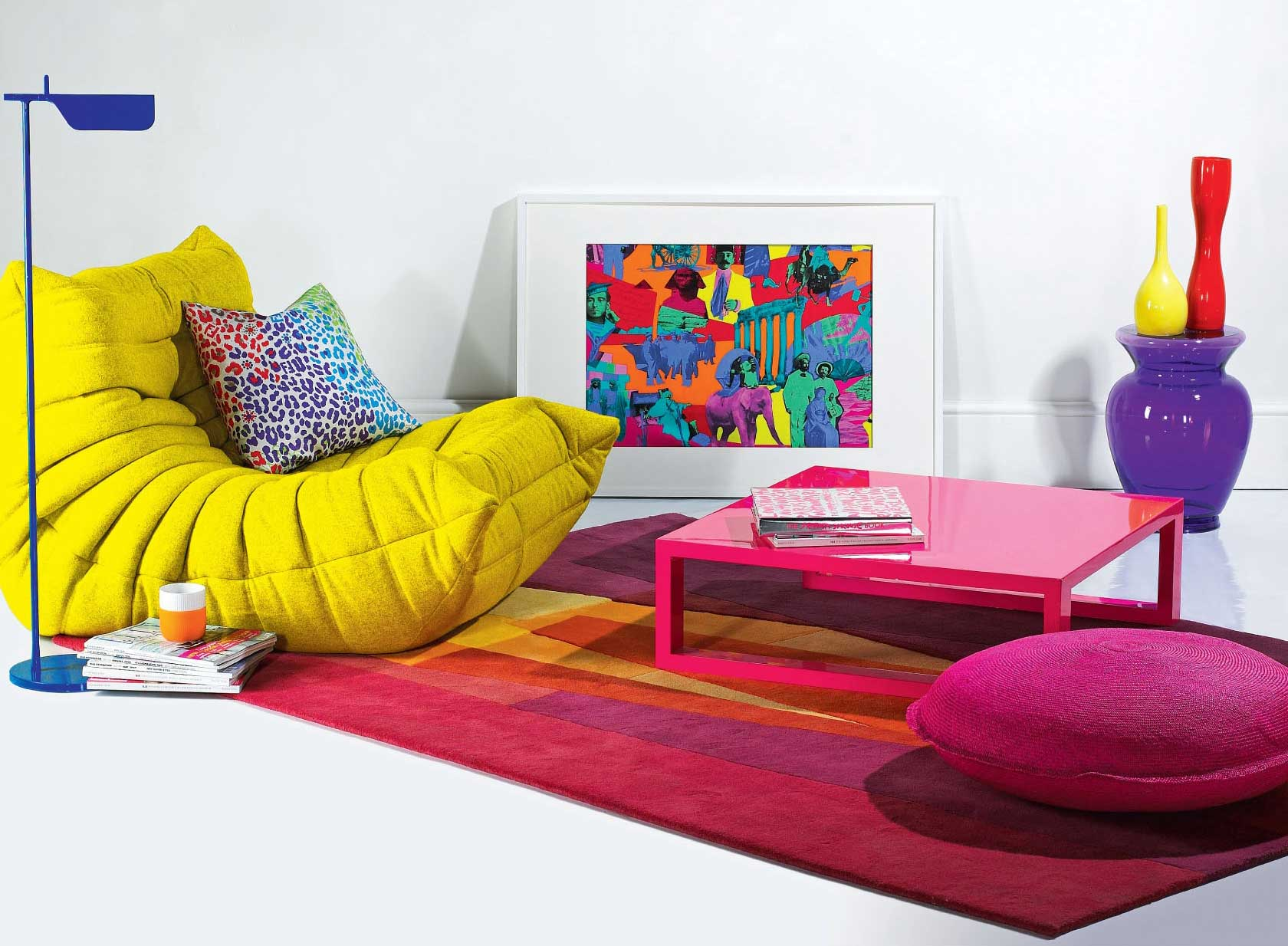 Yellow Togo Sofa by Ligne Roset with Kaleidoscope Red Rug by Sonya Winner